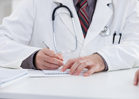 Doctor writing a prescription.
