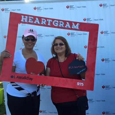 two women holding a photo frame during a heart walk