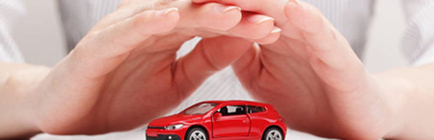Hands Covering A Toy Car Like Car Insurance