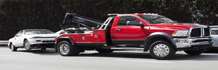 Car-being-hauled-by-tow-truck