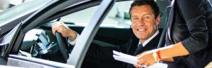 smiling-man-inside-car